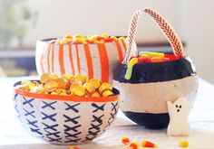 Expecting trick-or-treaters on Halloween? Hand out those fun-size candy bars in style with this awesome papier-mâché candy bowl tutorial!