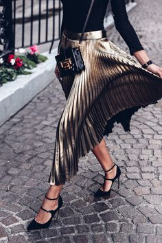 metallic pleats + velvet heels.