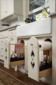 Beautiful carved, pull out kitchen drawers for towel, cleaning supplies, and paper towel storage