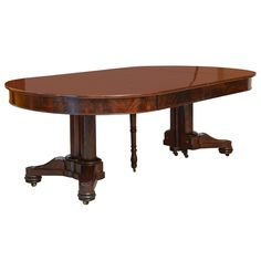 A Fine French Empire Mahogany Concertina Action Extension Dining Table