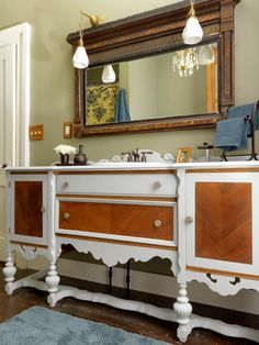 An old dining room sideboard and a secondhand sink were converted into a lengthy bathroom vanity. Design by Joanne Palmisano