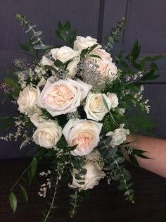 Bridal bouquet of white ohara garden roses, vandella roses, white majolica spray roses and various eucalyptus greens