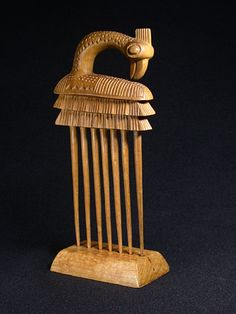 Africa | Comb from the Baule people of the Ivory Coast | Wood | 1970 | Given that this comb comes complete with a stand it is likely that it was made to order by a colon or expatriate person.