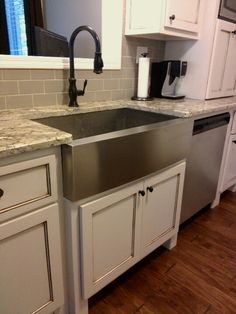 Great White Cabs, SS Apron Sink, Granite Counters, And Oil Rubbed Bronze Faucet.