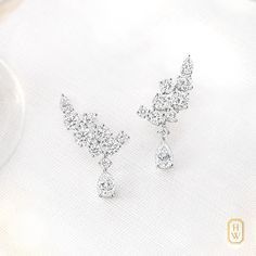 Radiant from ear to ear. #Diamond earrings from the Sparkling Cluster by #HarryWinston collection.