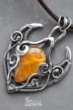 Natural baltic amber silver wire wrapped pendant