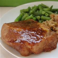 Marinated Baked Pork Chops Recipe - Pork chops cook in a tangy marinade of soy sauce, Worcestershire, and prep! Pork Chop Recipes, Meat Recipes, Cooking Recipes, Entree Recipes, Yummy Recipes, Marinated Baked Pork Chops, Bacon, Chops Recipe, Pork Dishes