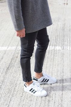 long grey sweater over black jeans white adidas shoes - fashion