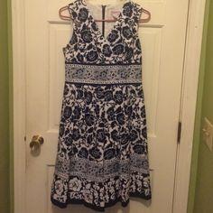 Chadwick's blue and white floral dress Blue and white floral dress. So pretty  size 8P. Zippers up back: Chadwicks Dresses