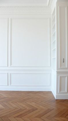 living rooms - herringbone floor, herringbone wood floor, herringbone hardwood floor, herringbone pattern floor, crown moldings, ornate crown moldings, crown molding millwork, molding millwork, built ins, decorative moldings, decorative wall moldings, wall panels, wainscoting,