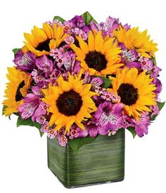 My two favorite things sunflowers and the color purple.... put them in a mason jar for a beautiful center piece