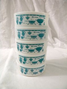 Fire King stack bowls with the turquoise kitchen appliances...