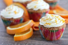Moist, fluffy Carrot Cake Cupcakes combined with the tropical flavor of coconut, and topped with an Orange Cream Cheese Frosting! You have t...