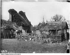 CC79/00514 A small group of thatched buildings, possibly forming a farmstead, in Frisby on the Wreake. In the foreground a man and a woman are engaged in the sale of goods, whilst, in the distance, the spire of St Thomas of Canterbury's Church can be seen PlaceFrisby On The Wreake, Leicestershire  The man can also be seen in CC79/00515.  Date14 Mar 1885 Photographer: London Midland and Scottish Railway Historical Images, St Thomas, Small Groups, Distance, Buildings, England, London, Woman, House Styles