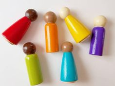 Set of 6 wooden rainbow peg dolls. These cute wooden peg dolls are perfect for little toddler hands, and are painted in bright rainbow colors! Our rainbow peg dolls are hand sanded and painted with non-toxic water based paint. Each of the 6 peg people is 3 1/2 tall X 1 1/2 wide.