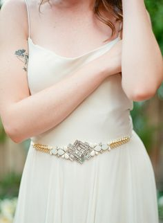 Intricately beaded art deco design belt with crystals, ivory beading, and gold accents. The perfect addition to glam up a simple gown, or to