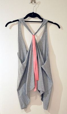 How to cut a t-shirt like this! all you need are scissors and a ribbon!