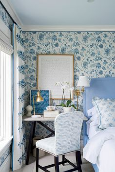 """""""I love a writing desk as a bedside table,"""" says Sikes. This one comes with no shortage of inspiration, as it boasts some of the best views in the house."""