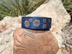 hand made leather cuff/blue leather cuff/cuff/stamped flower cuff/leather bracelet/leather jewelry/floral cuff/girls cuff/womans cuff/ #leathercuffs #upcycledleathercuffs #longshotleather