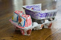 Dump truck made from an egg carton. This craft will require an adult to help.