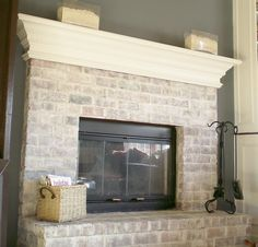 White washed brick....looks exactly like house I grew up except mantle was darker... we helped build the fireplace or at last cleaned the bricks.   Ha White Wash Brick Fireplace, Painted Brick Fireplaces, Fireplace Redo, Fireplace Makeovers, White Mantle, Fireplace Whitewash, Fireplace Ideas, Fireplace Hearth, Fireplace Modern