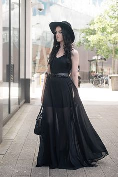 Fashion blogger Stephanie of FAIIINT wearing Choies black chiffon maxi dress, Catarzi Fedora, ASOS & Topshop studded wrap belt, RockLove sacred geometry gold chevron necklace, Kurt Geiger boots, Balenciaga city. All black summer goth street style outfit.