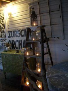 Ladder lit with candles and vintage dresser