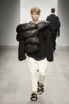 what a wierd jacket...maybe he's trying to be King Kong.
