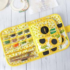 """Organizer for cross stitch Bees and sunflowers."""