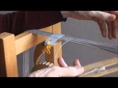 Weaving narrow bands with a double holed heddle - YouTube