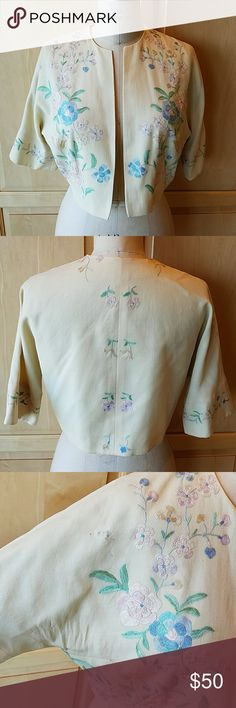 """gorgeous vintage shabby chic wool bolero Super light weight wool in the lightest yellow with beautiful embroidery in pastels Some moth holes, see photo, I loved the piece anyway, they just don't make them like this anymore... Some rips in the lining, see photo, doesn't show when worn No label, my best guess for vintage is 50's based on the silhouette Bust measures 42"""" Length from shoulder is 17"""" Vintage Jackets & Coats"""