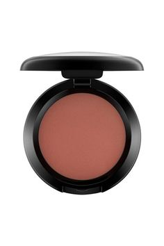 """M.A.C. Cosmetics Powder Blush in Raizin  ELLE.com Senior Fashion Editor Nikki Ogunnaike says, """"Much like my favorite lip liner, this blush came by recommendation from my sister in the early '00s...I love its natural, matte finish, and the fact that a little bit of the pigmented shade goes a long way. I consider it a must-have for any brown girl makeup kit."""""""