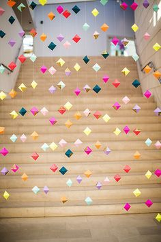 Decor- Walls of hanging geometric origami garland in vivid pastels and metallics. Could also be used as a photo booth backdrop