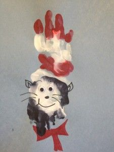 Dr. Suess art project: Cat in the hat hand print craft for kids! www.facebook.com/preschooluncut