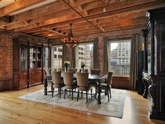 Gorgeous dining room, full of exposed wood beams, brick and refined over-sized furniture.