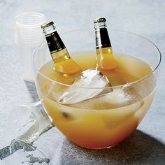This best-ever rye and beer punch comes with a cheeky garnish: two bottles of Miller High Life. Get the recipe from Food & Wine. Easy Halloween Cocktails, Halloween Punch, Halloween Treats, Happy Halloween, Halloween Costumes, Wine Cocktails, Cocktail Recipes, Alcoholic Drinks, Beverages