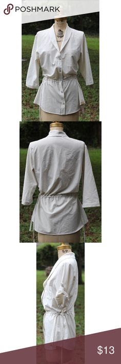 """Merrell Off White Drawstring Shirt M Cute Merrell Button Front Shirt, M. 100% Polyester. Laying flat it measures approximately: shoulder to bottom 29"""", armpit to armpit 17"""". Nice overall condition. Smoke free home. Thanks! Merrell Tops Button Down Shirts"""