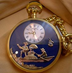 Charles Reuge Musical Pocket Watch Automaton has a small Reuge music box mechanism and 3 moving automata features on the watch face.