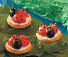ladybug appetizers.  Made similar design with Cream Cheese, Sweet Thai Chili sauce.  Couldn't get the black food coloring.