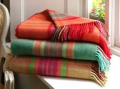 These 100% pure wool throws are one of our best selling products and have multiple uses from being thrown over the end of a bed, to cuddlying up in it in a chair to having a picnic in summer. Woven in Co. Tipperary, they are available in many wonderful designs and colours.  They are available in pure wool, lambswook and mohair.