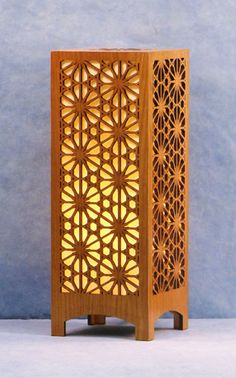 Decorative laser cut wood accent lamp. This pattern is adapted from a Japanese window transom, an architectural feature of a traditional Japanese home.