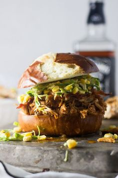 Crockpot Bourbon Brown Sugar Pulled Chicken Sandwiches with Bacon and Brussels Sprout Corn Slaw #slowcooker #crockpot #chicken #recipe