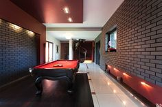 Snooker table in luxury brick walled basement www.inspiredhomeideas.com/home-basement-decorating-ideas/