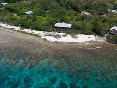 Aerial View of Coral Beach Inn and Surrounding Waters