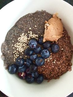 Breakfast: oatmeal with a bit of almond milk. Toppings: sesame seeds, flaxseeds, chia, peanut butter and blueberries.