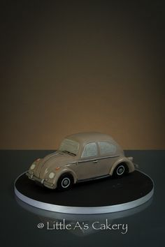 VW Beetle Birthday Cake. A replica of the Birthday boys rare 1967 Beetle. Hidden inside are layers of vanilla sponge, buttercream and raspberry jam!