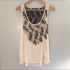 F21 White Tank Top with Black Lace And Rhinestones White flowy tank top that has black lace details and rhinestones on the front. Never worn, in perfect condition. Forever 21 Tops Tank Tops