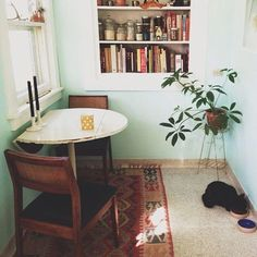 We could do something clever with our dining room cabinet space- take the doors off of it and turn it into a recessed shelving thing? Contrast paint?: