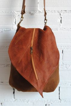 Leather backpack-handbag with leaf flap. Convertible according to the occasion. Brown colour. The flap has a zipper pocket as the handbag. Lining with inside zipper pocket. Adjustable handle...