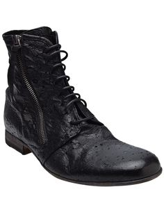 Perforated zip lace-up boot in black from Bordese. This distressed perforated leather ankle boot features an eight-eye lace-up panel, exposed zipper closure with leather zipper pull on both sides of shaft, and wooden heel. Heel measures 1